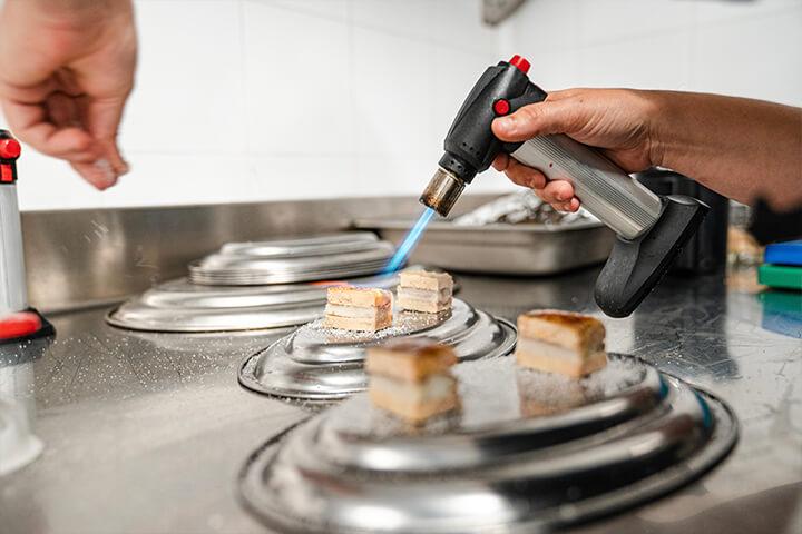 Cooking at Etxeko Ibiza restaurant