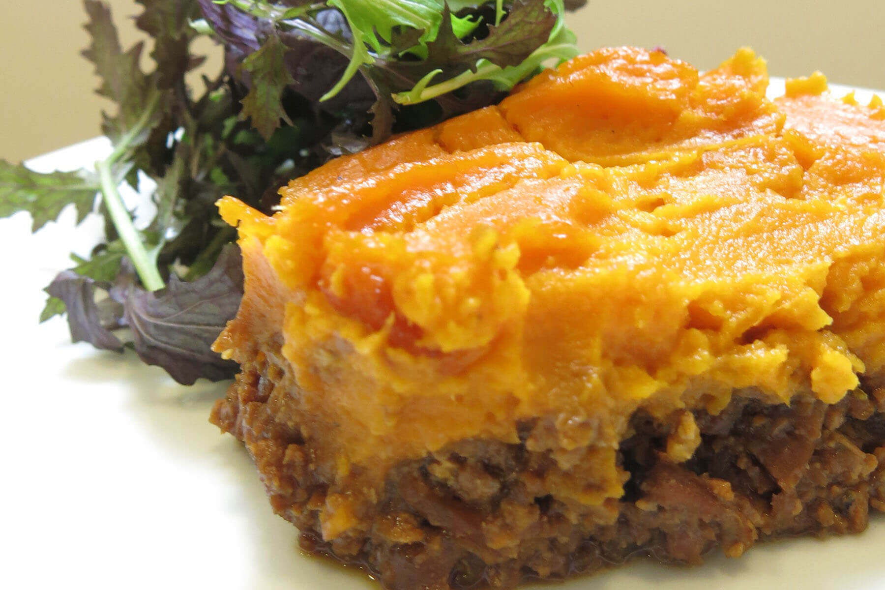Seitan pie with sweet potato purée