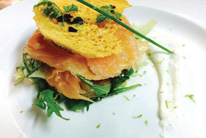 Salmon and arugula with crunchy bread slice. Ama Lur restaurant in Ibiza.