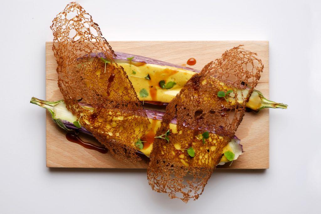 Autochthonous aubergine with garum and carob bread. Restaurant Re.Art, Ibiza