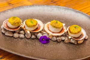 Shellfish with Parmesan sauce. Coricancha Nikkei Restaurant & Lounge Bar