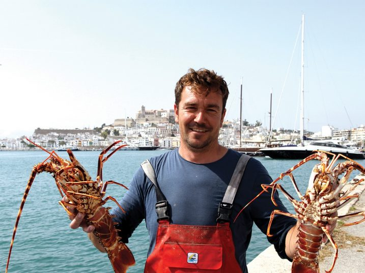 Toni Sastre with a pair of ibizan lobsters