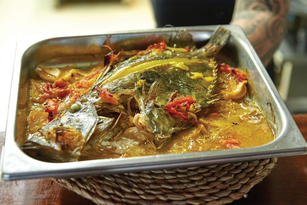Pescado al horno. Restaurante Es Caló, Formentera
