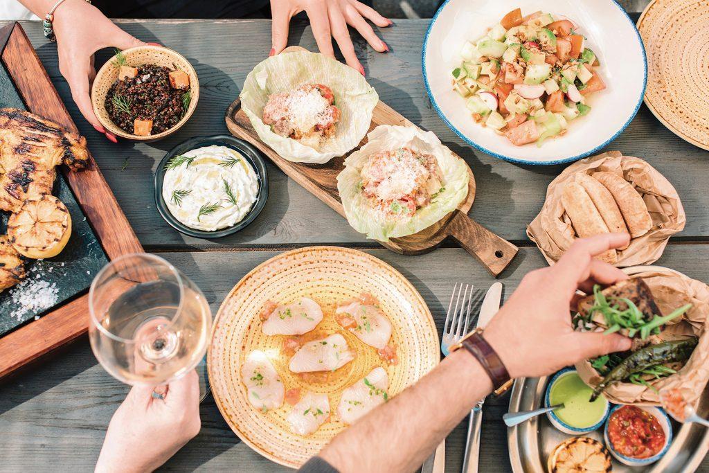 Yellowtail sashimi, raff tomato salad, araies, tzatziki, Tabule y nicoise bluefin tuna. Chiringuito Blue, Ibiza