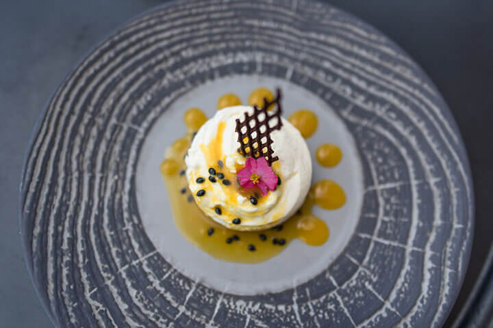 Cheesecake with passion fruit. Restaurant Amante Ibiza