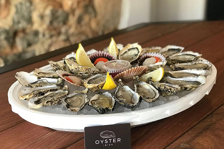 Oysters and scallops. Oyster Ibiza