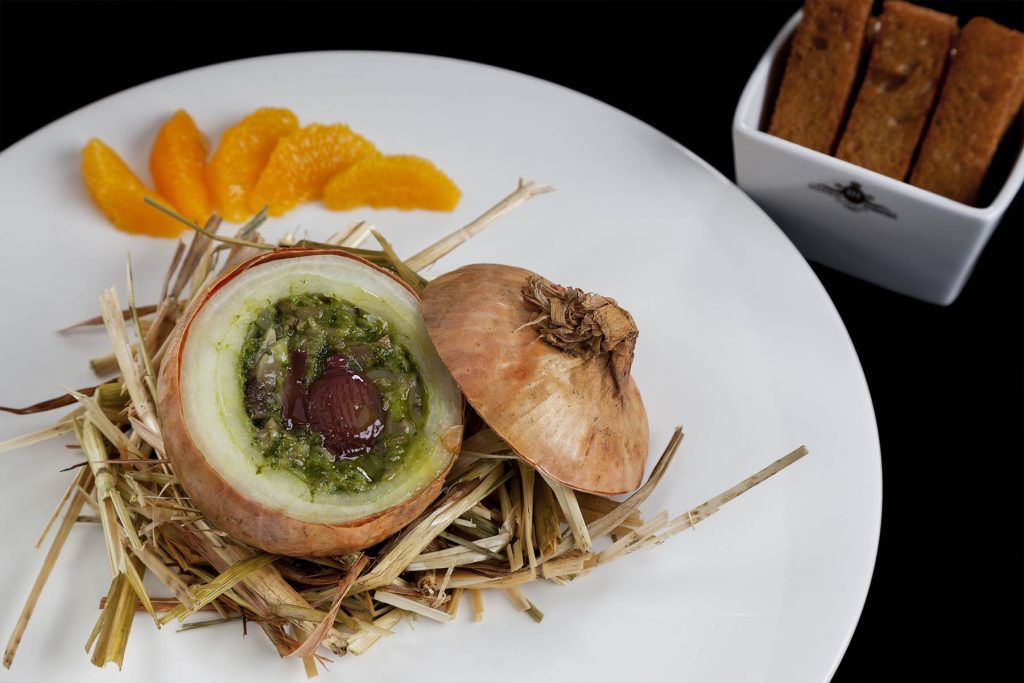 Stuffed onion with pork feet and coriander Restaurant Narcissus Fernandesii. Vila Viçosa