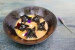 Raviolis cebra con langosta, gambas, stracciatella, tomate confitado y suquet de pescado